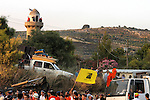 Settlers celebrate while escorting trucks carrying the belongings of new families that have just moved-in, at the Israeli settlement of Sa-Nur, West Bank.<br /> Thousands of settlers gathered in Sa-Nur that day, to welcome and assist 13 settler families, which recently moved-in to the settlement, some 2 months before Sa-Nur is due to be evacuated as part of Israel's pullout from Gaza and the northern West Bank.