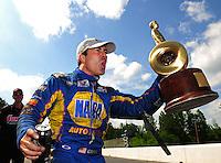 May 6, 2012; Commerce, GA, USA: NHRA funny car driver Ron Capps celebrates after winning the Southern Nationals at Atlanta Dragway. Mandatory Credit: Mark J. Rebilas-