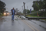 Allen Hartfield walks past downed electric lines on County Road 101 near the Lafayette County Industrial Park in Oxford, Miss. on Wednesday, April 27, 2011.