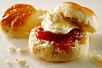 Traditional English scone with clotted cream and jam food photos