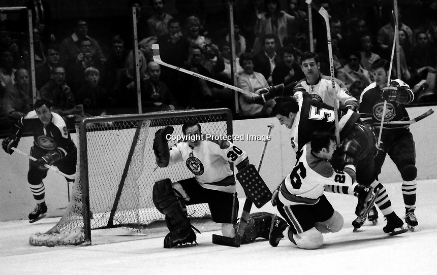 California Golden Seals vs Pittsburg Penguins 1970 Play-Off game. Seals Carol Vadnais trying to score..Penguins Dunc McCallum, goalie Les Binkley.<br />