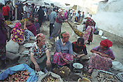 Women selling vegetables in the Jayma bazaar in the city of Osh. The city was once one fo the great cities of the Silk Road and of Central Asia, and is the second biggest city in the country, situated in the unstable Ferghana valley which is now becoming a hotbed if Islamic Fundamentalism. Osh, Kyrgyzstan.