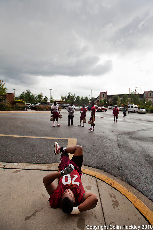 TALLAHASSEE, FL 8/6/12-FSU080612 CH-Florida State's Josue Matias relaxes during a weather delay of the Aug. 6 practice in Tallahassee. .COLIN HACKLEY PHOTO