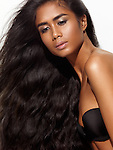 Beauty portrait of a young dark-skinned woman with beautiful healthy long brown hair