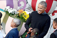 United States President Barack Obama laughs as he hands out treats to a kid who is dressed up as him during a Halloween event at the South Lawn of the White House October 31, 2016 in Washington, DC. The first couple hosted local children and children of military families for trick-or-treating at the White House<br /> Credit: Olivier Douliery / Pool via CNP /MediaPunch