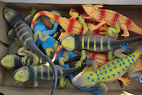 colorful lizard toys in a box