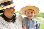 Old Bethpage, New York, USA - July 21, 2012: MICHELE WALKER of Coram and her son ROBERT WALKER, 4, wear clothes of American Civil War era while portraying family members of Union soldiers at Camp Scott re-creation, at Old Bethpage Village Restoration, to commemorate 150th Anniversary of American Civil War, on Saturday, July 21, 2012.