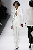 Model walks runway in an ivory loro piana wool/angora trouser suit w/sculted mink collar + hand-top-stitching, from the Zang Toi Fall 2012 &quot;Glamour At Gstaad&quot; collection, during Mercedes-Benz Fashion Week New York Fall 2012 at Lincoln Center.