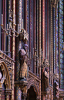 View from the side of the walls of the nave flanked by statues of apostles, Upper chapel of La Sainte-Chapelle (The Holy Chapel), 1248, Paris, France. La Sainte-Chapelle was commissioned by King Louis IX to house his collection of Passion Relics, including the Crown of Thorns. The Sainte-Chapelle is considered among the highest achievements of the Rayonnant period of Gothic architecture. Picture by Manuel Cohen