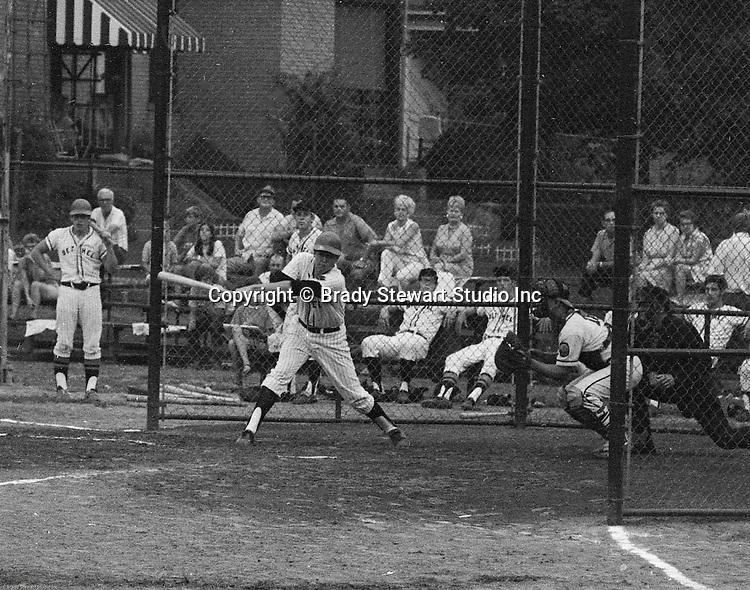 American Legion Baseball:  Bethel Park vs Arnold to advance to the state American Legion Playoffs.  Bob Purkey Jr swinging and missing during the game.  Bob Purkey pitched a shut out (1-0) and the team advance to the state playoffs in Allentown PA - 1970. Others in the photo; Mr and Mrs Bob Purkey Sr, Mike Stewart, Paul Hauck, Gary Biro, Craig Balmford and Bob Colligan
