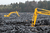 Bags containing debris and topsoil that has been removed in an effort to decontaminate areas affected by the meltdowns and explosions at Fukushima Daichi Nuclear power station caused by the earthquake and tsunami on  March 11th 2011 inside the nuclear exclusion zone, Tomioka, Fukushima, Japan. Wednesday, March 9th 2016
