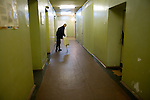 Andrei, 31, a former drug user who is HIV positive, walks to his room at Botkin Hospital in St. Petersburg, Russia, on Wednesday, September 12, 2007. Though he learned his HIV status six years ago, he only gave up drugs and started seeking treatment less than a year ago when he came down with pneumonia. Since then, he has lost 30% of his body weight but will soon start anti-retroviral treatment.