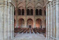 Nave seen from the South ambulatory, in the Basilique Saint Remi or Abbey of St Remi, Reims, France. The 11th century, mainly Romanesque, church, contains the relics of St Remi, the Bishop of Reims, who converted Clovis, the King of the Franks, to Christianity in 496 AD. The abbey is a UNESCO World Heritage Site. Picture by Manuel Cohen