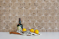 Calla, a handmade mosaic shown in honed Jura Grey, is part of the Miraflores Collection by Paul Schatz for New Ravenna.<br />