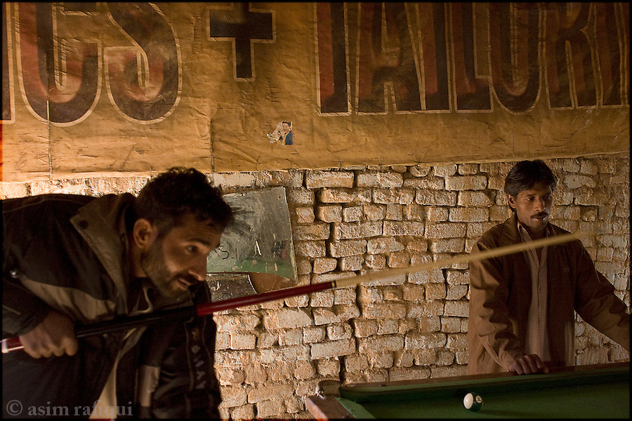 at a pool hall in a Karachi slum