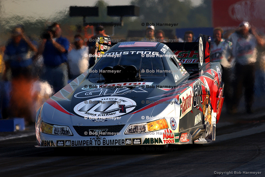 INDIANAPOLIS, IN - SEPTEMBER 6: John Force leaves the starting line during the NHRA Mac Tools US Nationals on September 6, 2002, at Raceway Park near Indianapolis, Indiana.