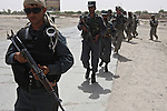 Afghan police and U.S. troops head out on a patrol of the Maiwand district bazaar in Kandahar province, Afghanistan. U.S. advisors are training and mentoring the police as a first line of defense against Taliban fighters in southern Afghanistan, where insurgent violence has risen sharply in recent years. Aug. 8, 2008. DREW BROWN/STARS AND STRIPES
