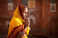 A  Hindu woman prays for morning prayers.