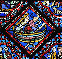 Noah and his son building the ark, from the Life of Noah stained glass window, 13th century, in the nave of Chartres cathedral, Eure-et-Loir, France. Chartres cathedral was built 1194-1250 and is a fine example of Gothic architecture. Most of its windows date from 1205-40 although a few earlier 12th century examples are also intact. It was declared a UNESCO World Heritage Site in 1979. Picture by Manuel Cohen