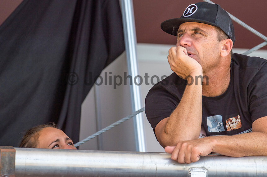 Snapper Rocks COOLANGATTA, Queensland/Australia (Friday, March6, 2015) Carissa Moore (HAW) and her father Chris Moore (HAW) watch the surf. before her heat.. - Round 3 and Round 4 were completed today in the  Roxy Pro Gold Coast. The event got underway today at 11.30 a.m. local time after being put on hold twice during the morning.<br /> <br /> Quarterfinalists were decided today at the Roxy Pro Gold Coast presented by BOQ, the opening stop on the Samsung Galaxy World Surf League (WSL) Championship Tour. The world&rsquo;s best battled through Rounds 3 and 4 in small, clean surf at Snapper Rocks and the field was narrowed down to just eight surfers.<br />  <br /> Silvana Lima (BRA) delivered the most dominant performance of the Roxy Pro to date, posting the first Perfect 10 of season in her heat against Sally Fitzgibbons (AUS). Despite a blistering start from the Australian with a near-perfect 9.63, the Brazilian unleashed her full repertoire on the Snapper Walls, using her air game and power turns to take her place in the Quarterfinals.<br /> <br /> Chevy Metal, the cover band formed more than a decade ago by Taylor Hawkins (Foo Fighters/The Birds of Satan), played a free show after competition wrapped up. <br /> Featuring Hawkins along with Wiley Hodgden (Bass/Vocals), Chris Shiflett (Guitar) and Rami Jaffee (Keys), Chevy Metal will ripped into some deep cuts off albums by Rolling Stones, Queen, The Police, Black Sabbath, Van Halen and more. Stephan Gilmore (AUS) and Andrew Stockdale (AUS) of Wolfmother famed joined  Chevy Metal on stage.<br /> -  Photo: joliphotos.com