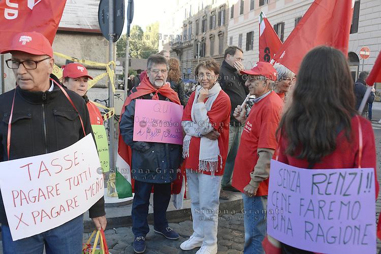 Roma, 25 Ottobre 2014<br /> Lavoro. La CGIL manifesta a Roma con due cortei nazionali fino a Piazza San Giovanni , contro il jobs act e la riforma dell'art.18 del governo Renzi.<br /> <br /> CGIL protest against the jobs act and the reform of article 18 of the government Renzi.<br /> <br /> Rome, October 25, 2014 <br /> Work. The national union CGIL manifested in Rome with two national marches to Piazza San Giovanni, against the jobs act and the reform of article 18 of the government Renzi.