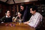 Berkeley CA Nuclear family, latino father, playing block balancing game together, children ten and fourteen-years-old  MR