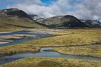 Rivers flow through Tjäktjavagge valley south of Sälka hut, Kungsleden trail, Lapland, Sweden
