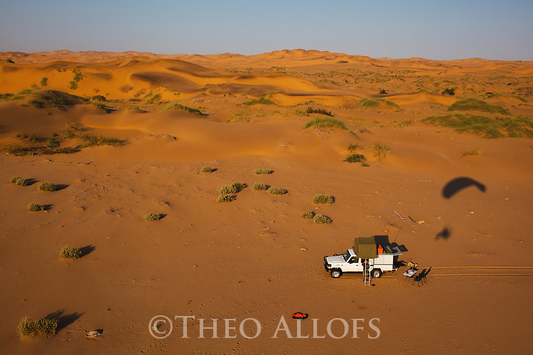 Namibia;  Namib Desert, Skeleton Coast,  4x4 vehicle on dunes near Walvis Bay, aerial view, image taken from powered paraglider