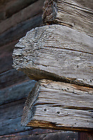 The cabin is built of weathered rough-hewn logs