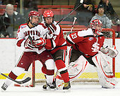 Marshall Everson (Harvard - 21), Pete Child (St. Lawrence - 4), David Grilk (St. Lawrence - 33) - The Harvard University Crimson defeated the St. Lawrence University Saints 4-3 on senior night Saturday, February 26, 2011, at Bright Hockey Center in Cambridge, Massachusetts.