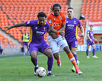 Blackpool's Nathan Delfouneso vies for possession with Cheltenham Town's Jordan Cranston<br /> <br /> Photographer Alex Dodd/CameraSport<br /> <br /> The EFL Sky Bet League Two - Blackpool v Cheltenham Town - Saturday 22nd April 2017 - Bloomfield Road - Blackpool<br /> <br /> World Copyright &copy; 2017 CameraSport. All rights reserved. 43 Linden Ave. Countesthorpe. Leicester. England. LE8 5PG - Tel: +44 (0) 116 277 4147 - admin@camerasport.com - www.camerasport.com