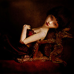 portrait of girl doll reclining