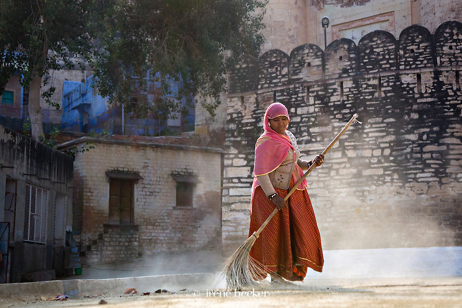 Sweeper Woman. An Indian woman cleaning the streets in the morning. Jodhpur, Rajasthan, India.