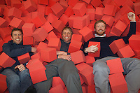 Duncan Callahan, David Wiens and Jason Holton fall into a foam pit in Western's new Field House and Recreation Center.