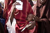 Kenya - Dadaab - Somali refugees qeeuing at Dagahaley registration center.