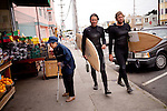 Danny Hess, right, who specializes in making custom surfboards out of sustainable wood, walks back with Josh Duthie, left, from surfing at Ocean Beach, in San Francisco, Ca., on Wednesday, July 6, 2011.