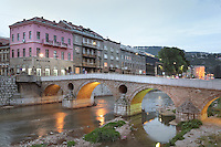 The Latin Bridge, originally a 16th century Ottoman bridge over the river Miljacka but rebuilt 1798-99, and on the left, the Museum of the Assassination of Franz Ferdinand, marking the spot where, on the 28th June 1914, Gavrilo Princip assassinated Archduke Franz Ferdinand and his wife Sofia, an act which led to the outbreak of the First World War, Stari Grad, Sarajevo, Bosnia and Herzegovina. The bridge is a National Monument. Picture by Manuel Cohen