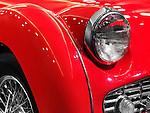 Red 1959 Triumph TR3A classic retro car closeup  of details