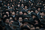 Ultra-orthodox Jewish men gather outside Mir Yeshiva religious school in Jerusalem, Israel, during the funeral of Rabbi Refoel Shmulevitz. Rabbi Shmulevitz was the head of Mir Yeshiva, one of the largest Yeshivas in Israel with more than 7500 students coming from all over the world.