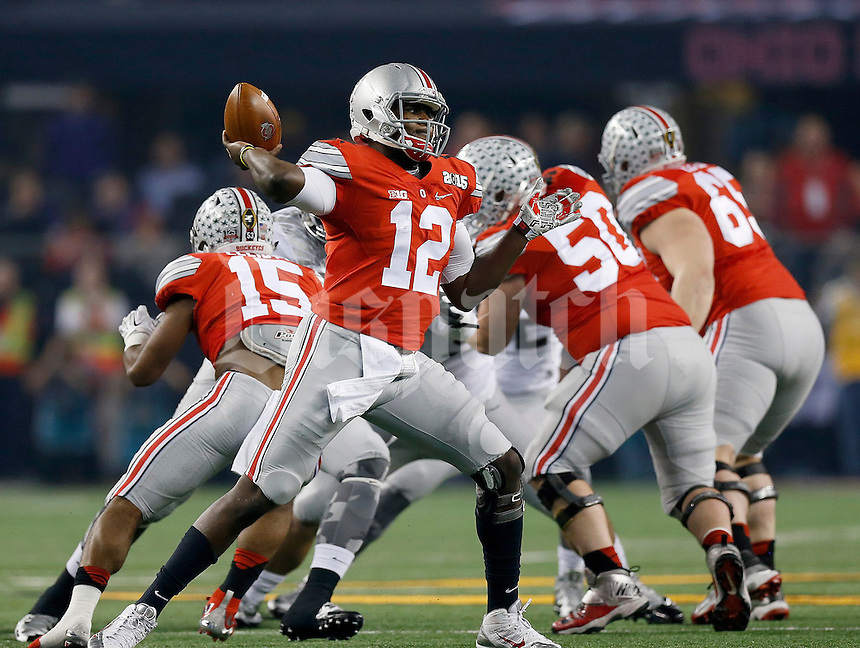 Ohio State Buckeyes quarterback Cardale Jones (12) during the first quarter the College Football Playoff National Championship at AT&T Stadium in Arlington, TX on Monday, January 12, 2015. (Columbus Dispatch photo by Jonathan Quilter)