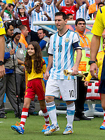 Lionel Messi of Argentina walks out of the tunnel with a mascot