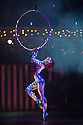 London, UK. 04.01.2014. Cirque du Soleil present QUIDAM at the Royal Albert Hall. Artists on the aerial hoops are Danila Bim, Lais Camila and Lisa Skinner. © Jane Hobson.