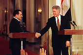 President Hosni Mubarak of Egypt and United States President Bill Clinton shake hands after their opening remarks at a joint press conference in the East Room of the White House in Washington, D.C. on Monday, March 10, 1997..Credit: Ron Sachs / CNP