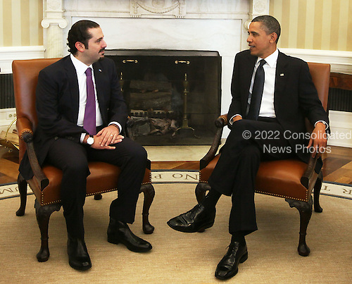 "United States President Barack Obama (R) meets with Prime Minister Saad Hariri (L) of Lebanon in the Oval Office of the White House Wednesday, January 12, 2011 in Washington, DC.  According to a White House media release, the two leaders met ""to discuss U.S. support for Lebanonís sovereignty, independence, and stability, the ongoing work of the Special Tribunal for Lebanon, and other regional issues."" .Credit: Alex Wong / Pool via CNP.Credit: Alex Wong / Pool via CNP"