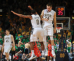 Pat Connaughton (24) celebrates with Eric Atkins (0) after his three.