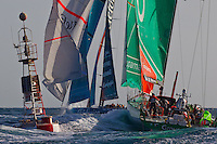 UAE. 4th January 2012. Volvo Ocean Race, Leg 2, arrival into Abu Dhabi. Team Telefonica leads Groupama Sailing Team around the final mark into Abu Dhabi.