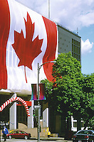 The Maple Leaf flag hanging from the Main Post Office on Canada Day, in downtown Vancouver, BC.