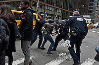 A man is arrested by a NYPD Officer during a protest against  Republican Presidential candidate Donald Trump in New York City 13.19.2016. Joana Toro/VIEWpress.