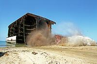 A ship is demolished at the Gaddani ship-breaking yard.