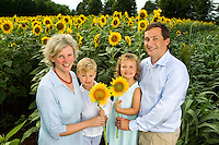 On-location photography of Charlotte's annual Field of Dreams event, during which Charlotte-area professional photographers donate their time creating images of cancer survivors. The sunflower field is located on farm land in Weddington, NC. Photographer Julie Staley of  Old South Studio&rsquo;s coordinates the event.<br /> <br /> Photo by: PatrickSchneiderPhoto.com